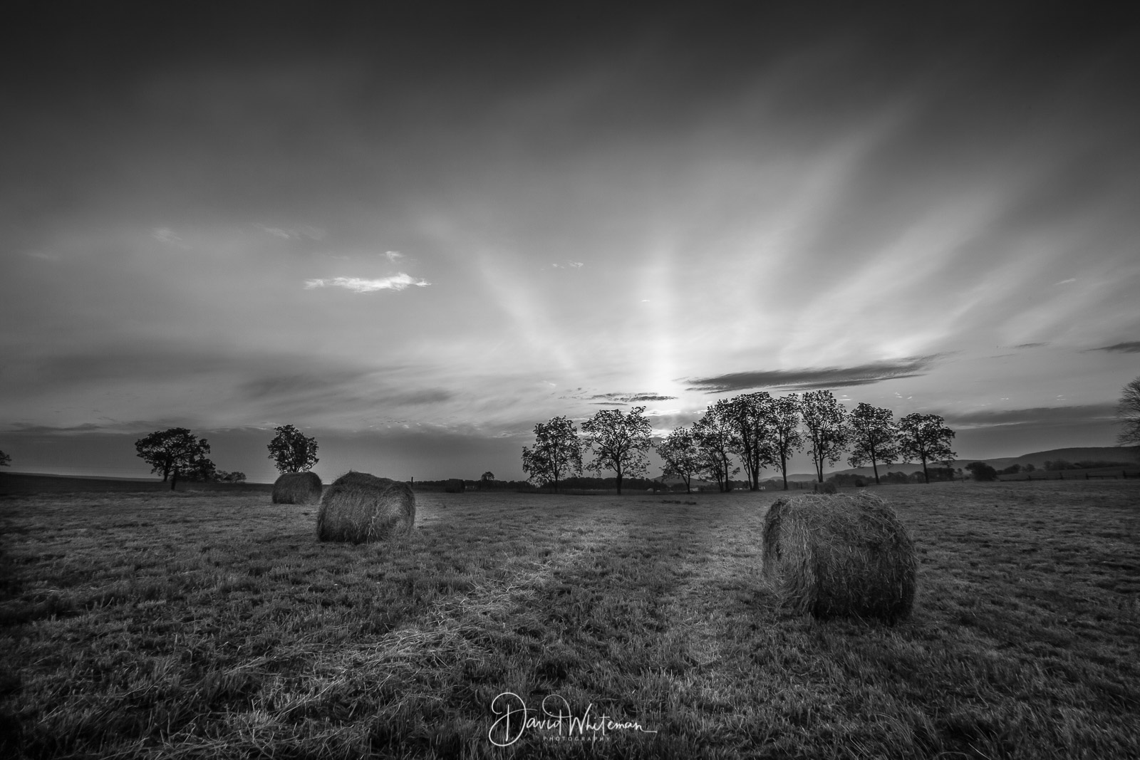 Sunrise Over The Hay Field
